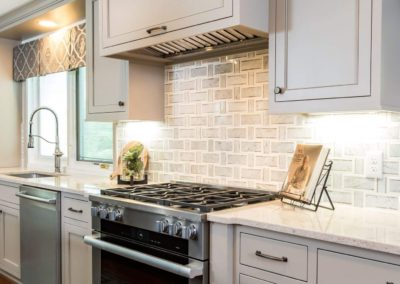 large stainless steel oven and range in gray kitchen