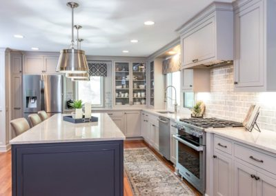 two toned gray kitchen with stainless steel appliances