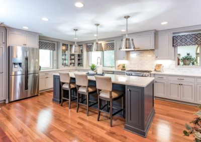 two toned gray kitchen with large island