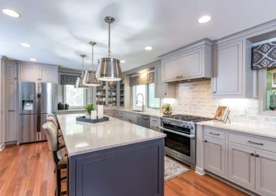 two toned gray kitchen with large island and oven range