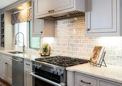 stainless steel oven and range with tile back splash