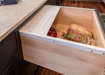pull-out bread drawer in custom kitchen