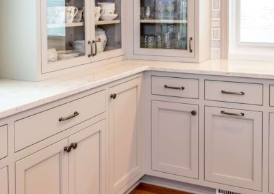 corner of kitchen with light gray cabinets