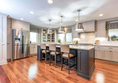 L shaped gray kitchen with island