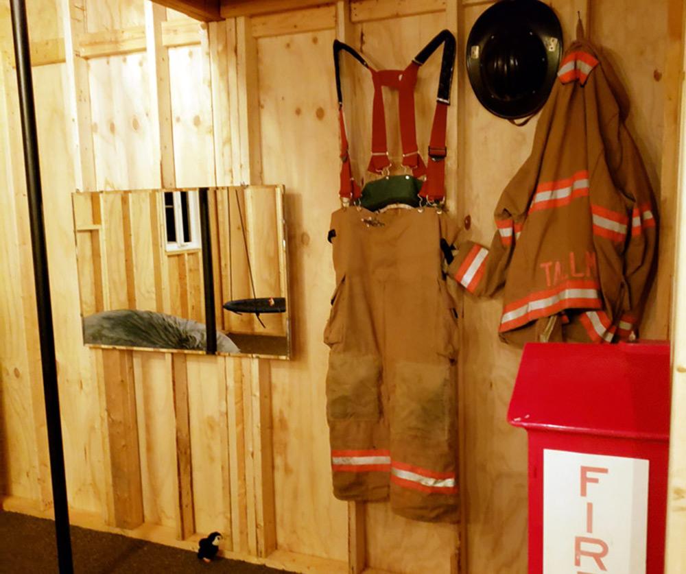 firefighter gear hanging in Ian's Treehouse