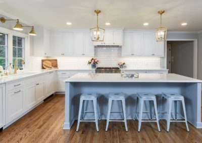 large island with seating in white kitchen