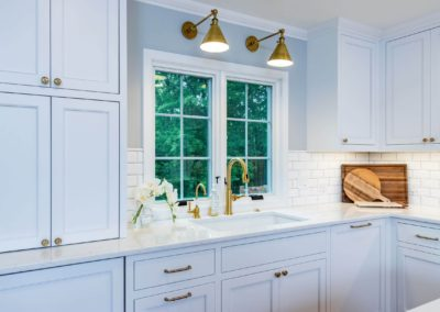 gold lights above undermount kitchen sink
