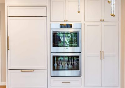 refrigerator with custom panels and double oven