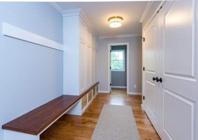 large mudroom with built in bench and storage