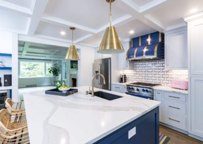 large kitchen island with gold pendant lighting
