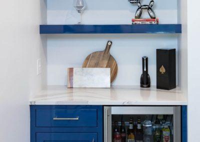 blue cabinet next to miniature fridge