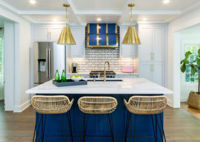 white kitchen with navy blue and gold accents