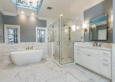 marble master bathroom with shower and soaker tub
